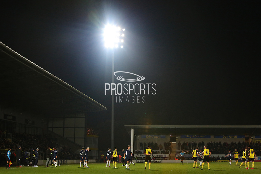 Action under the floodlights during the EFL Sky Bet League 1 match between Burton Albion and Southend United at the Pirelli Stadium, Burton upon Trent, England on 3 December 2019.