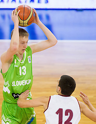 Miha Lapornik of Slovenia vs Davis Coders  of Latvia during basketball match between National teams of Latvia and Slovenia in Qualifying Round of U20 Men European Championship Slovenia 2012, on July 16, 2012 in Domzale, Slovenia. (Photo by Vid Ponikvar / Sportida.com)