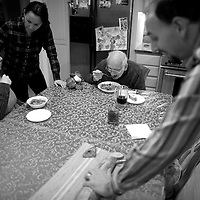 Mt. Laurel, NJ - Elizabeth Wolf, 35, and husband, Casey, serve dinner to her parents, Lou, 81, and Nancy, 65.  Wolf moved home to New Jersey 5 years ago and has been caring full-time for her parents who both have Alzheimer's.