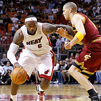 24 January 2012: Miami Heat small forward LeBron James (6) drives past Cleveland Cavaliers shooting guard Anthony Parker (18) during the Miami Heat 92-85 victory over the Cleveland Cavaliers at the AmericanAirlines Arena, Miami, Florida, USA.