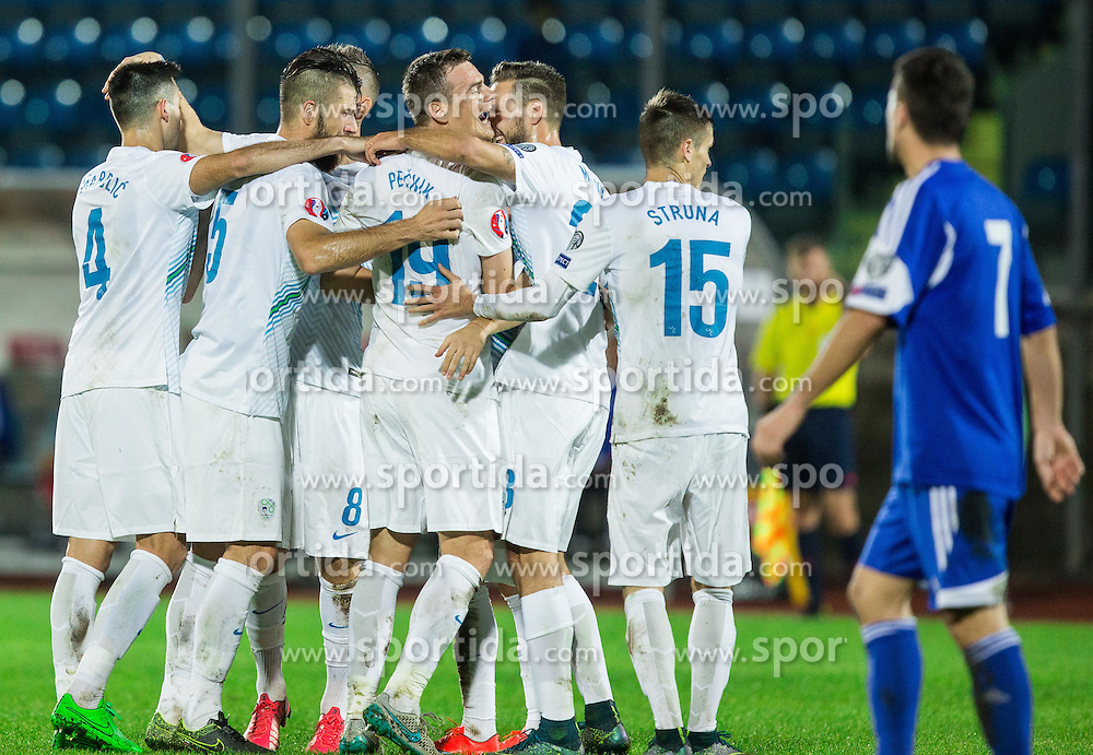Nejc Pecnik of Slovenia and other players celebrate after scoring second goal for Slovenia during football match between National teams of San Marino and Slovenia in Group E of EURO 2016 Qualifications, on October 12, 2015 in Stadio Olimpico Serravalle, Republic of San Marino. Photo by Vid Ponikvar / Sportida