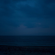 A faint light can be seen from aboard a dinghy carrying migrants across the Aegean Sea from Turkey to Lesbos island in Greece.