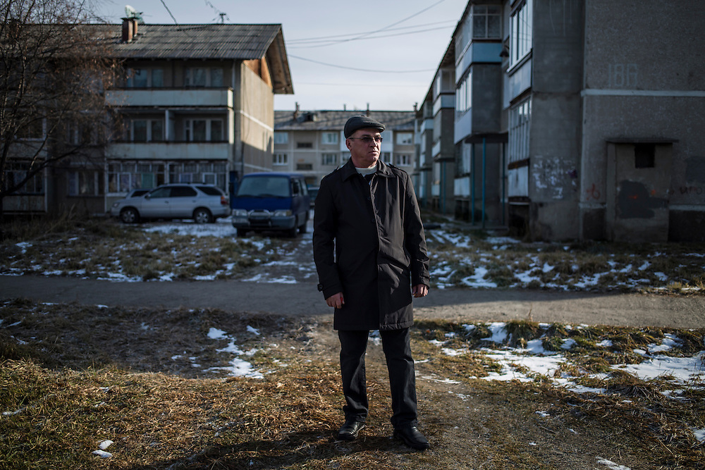 Mikhail Yeremin, a former worker at the Baikalsk Pulp and Paper Mill who was recently laid off, poses for a portrait on Wednesday, October 23, 2013 in Baikalsk, Russia.