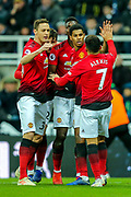 Marcus Rashford (#10) of Manchester United celebrates Manchester United's second goal (0-2) with Alexis Sanchez (#7) of Manchester United during the Premier League match between Newcastle United and Manchester United at St. James's Park, Newcastle, England on 2 January 2019.