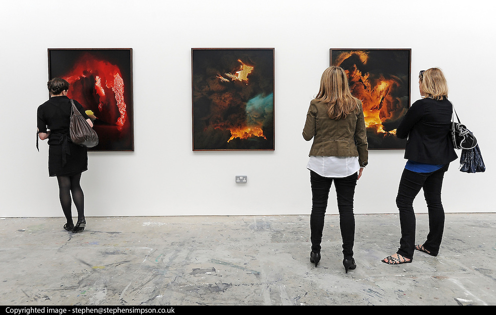 © licensed to London News Pictures. LONDON, UK.  22/06/11. women look at work by photography students Nadege Meriau. Students present their work at The Royal College of Art's Fine Art Graduate Show 2011. The show runs from 24th June-3rd July 2011. Mandatory Credit Stephen Simpson/LNP