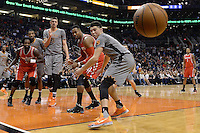 Feb 4, 2016; Phoenix, AZ, USA;  Houston Rockets guard Patrick Beverley (left), Phoenix Suns center Alex Len (21), Houston Rockets center Dwight Howard (12) and Phoenix Suns guard Devin Booker (1) watch the loose ball in the game at Talking Stick Resort Arena. Mandatory Credit: Jennifer Stewart-USA TODAY Sports
