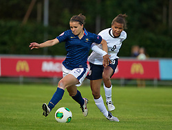 LLANELLI, WALES - Monday, August 19, 2013: England's Nikita Parris in action against France's Aurelie Gagnet during the Group A match of the UEFA Women's Under-19 Championship Wales 2013 tournament at Stebonheath Park. (Pic by David Rawcliffe/Propaganda)