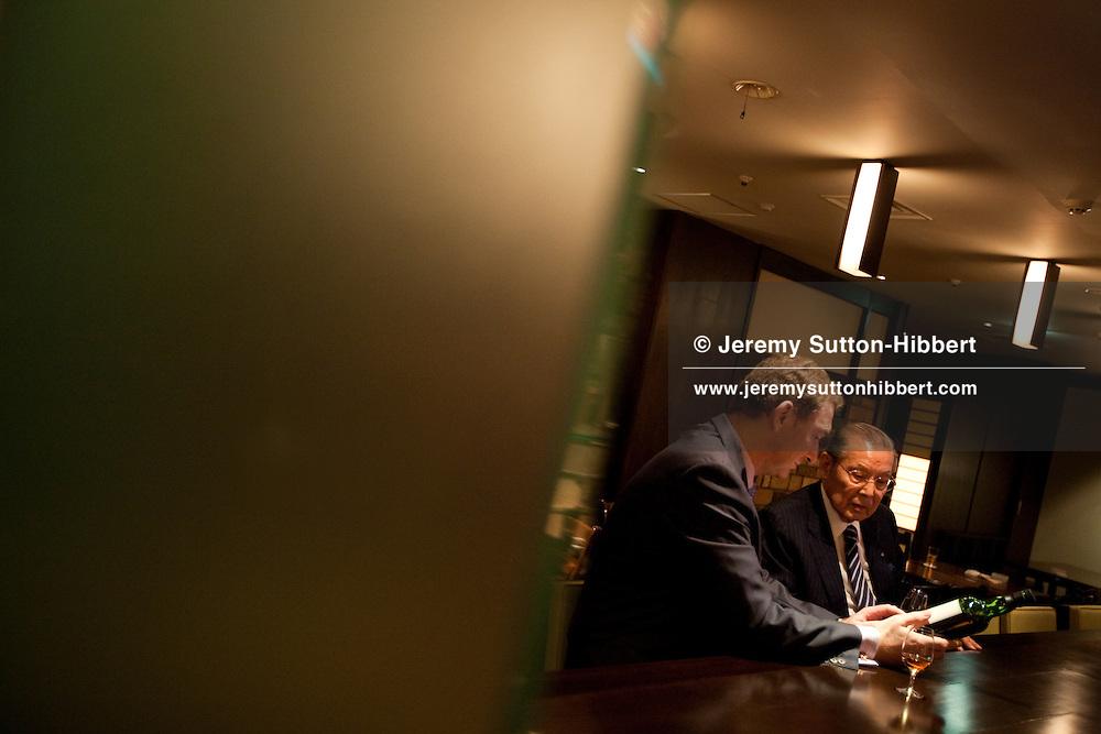 Scottish Whisky Society Japan's David Croll in conversation with Takeshi Taketsuru, son of Masataka Taketsuru and wife Rita, in Nikka Blender's Bar, Tokyo, Japan, on Wednesday 2nd September 2009.