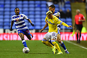 Ezgjan Alioski (10) of Leeds United battles for possession during the EFL Sky Bet Championship match between Reading and Leeds United at the Madejski Stadium, Reading, England on 12 March 2019.