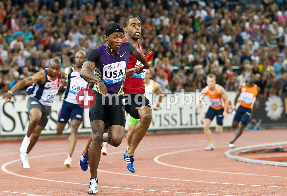 Michael Rodgers of the USA (C L) receives the baton from compatriot Tyson Gay (C R) during the men's 4x100m relay in the men's 4x100m Relay at the IAAF Diamond League meeting at the Letzigrund Stadium in Zurich, Switzerland, Thursday, Aug. 19, 2010. (Photo by Patrick B. Kraemer / MAGICPBK)