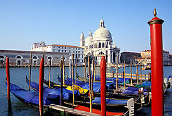 Venice, Italy: the famous Santa Maria Della Salute Church (1630-1687) stands near the mouth of the Grand Canal.  Gondolas in the foreground.