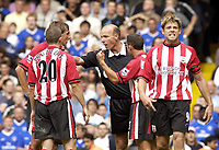 Fotball<br /> Foto: SBI/Digitalsport<br /> NORWAY ONLY<br /> <br /> Date: 28/08/2004<br /> <br /> Chelsea v Southampton FA Barclays Premiership<br /> <br /> Claus Lundekvam of Saints argues with the ref after he gave away a penalty for handball.