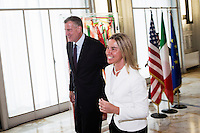 ROME, ITALY - 21 JULY 2014: (L-R) Mayor of New York Bill De Blasio and Italian Minister of Foreign Affairs Federica Mogherini leave a press conference they hel at the Ministry of Foreign Affairs in Rome, Italy, on July 21st 2014.<br /> <br /> New York City Mayor Bill de Blasio arrived in Italy with his family Sunday morning for an 8-day summer vacation that includes meetings with government officials and sightseeing in his ancestral homeland.