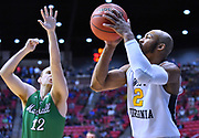 SAN DIEGO, CA - MARCH 18:  West Virginia Mountaineers guard Jevon Carter (2) shoots a three-pointer against Marshall Thundering Herd guard Ot Elmore (12) during a second round game of the Men's NCAA Basketball Tournament at Viejas Arena in San Diego, California. West Virginia won 94-71.  (Photo by Sam Wasson)