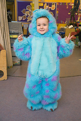 Primary school boy in fancy dress at Bring and Buy sale,