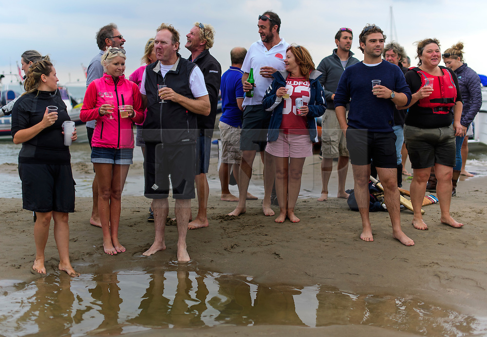 © Licensed to London News Pictures. 18/09/2016. Portsmouth, UK. Spectators watch on. Teams take part in the  Bramble Bank Cricket Match in the middle of The Solent strait on September 18, 2016. The annual cricket match between the Royal Southern Yacht Club and The Island Sailing Club, takes place on a sandbank which appears for 30 minutes at lowest tide. The game lasts until the tide returns. Photo credit: Ben Cawthra/LNP
