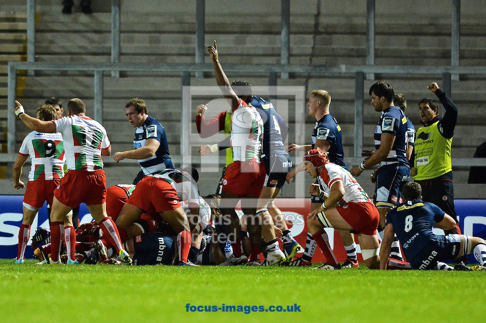 Picture by Ian Wadkins/Focus Images Ltd +44 7877 568959<br /> 10/10/2013<br /> Eugene Van Staden of Biarritz Olympique scores a try during the Amlin Challenge Cup match at AJ Bell Stadium, Eccles.