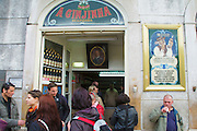 """People waiting or drinking outside """"A Ginjinha"""", one of the places where one can drink cherry liquor (ginjinha)."""
