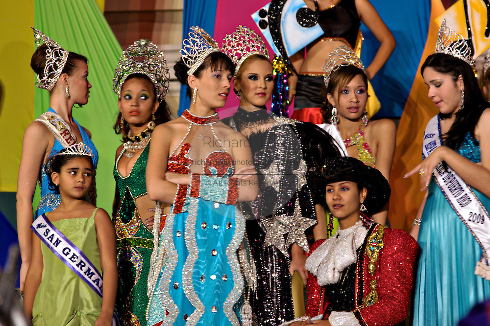 Beauty queens watch a procession during the Carnaval de Ponce February 21, 2009 in Ponce, Puerto Rico.