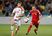 Spain's Santi Cazorla (r) and Belarus' Timofei Kalachev during 15th UEFA European Championship Qualifying Round match. November 15,2014.(ALTERPHOTOS/Acero)