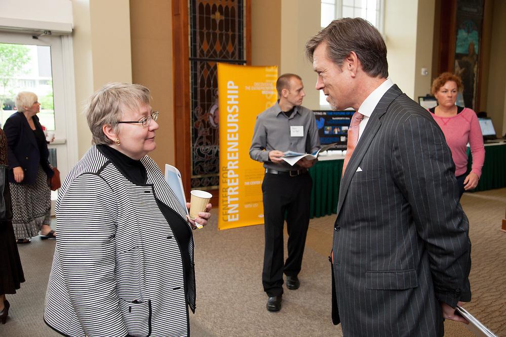 Ohio University Provost Pam Benoit talks with Matt Erskine, Deputy Assistant Secretary for Economic Development, during the 3rd annual Appalachian Ohio Sate of the Region Conference May 20, 2014.  Photo by Ohio University / Jonathan Adams