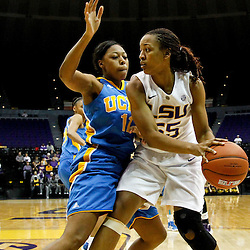 December 13, 2011; Baton Rouge, LA; LSU Lady Tigers forward LaSondra Barrett (55) is guarded by UCLA Bruins forward Atonye Nyingifa (11) during the first half of a game at the Pete Maravich Assembly Center.  Mandatory Credit: Derick E. Hingle-US PRESSWIRE