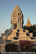 An ancient Buddhist stupa is illuminated by late afternoon sun at The Royal Palace complex in Phnom Penh, Cambodia. The Palace and grounds serve as one of Cambodia's top visitor attractions.
