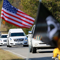 Thomas Wells | BUY AT PHOTOS.DJOURNAL.COM<br /> The hearse carring the remains of Cpl. George Mason makes its way past rows and rows of flags as it nears Emory Cemetray in Byhalia on Tuesday.