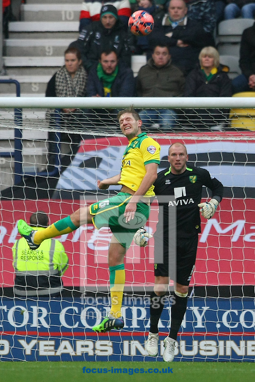Michael Turner of Norwich heads clear during the FA Cup match at Deepdale, Preston<br /> Picture by Paul Chesterton/Focus Images Ltd +44 7904 640267<br /> 03/01/2015