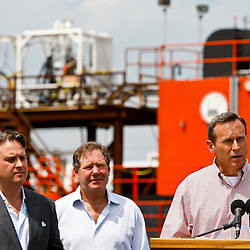 Ocean Therapy Solutions Chief Executive Officer, John Houghtaling II (left) and Ocean Therapy Solutions Chief Operating Officer, Patrick Smith (center) listen to BP Plc COO Doug Suttles during a press conference about Ocean Therapy Solutions oil separating centrifuge device that will be deployed by BP Plc that was demonstrated on a vessel at Hornbeck Offshore in Port Fourchon, Louisiana, U.S., on Tuesday, June 15, 2010. (Mandatory Credit: Derick E. Hingle)