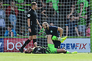 Forest Green Rovers physio Joe Baker tends to an injury to Forest Green Rovers Matt Mills(5) during the EFL Sky Bet League 2 match between Forest Green Rovers and Grimsby Town FC at the New Lawn, Forest Green, United Kingdom on 17 August 2019.