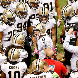 Oct 5, 2014; New Orleans, LA, USA; New Orleans Saints quarterback Drew Brees (9) huddles up with teammates prior to kickoff of a game against the Tampa Bay Buccaneers at Mercedes-Benz Superdome. Mandatory Credit: Derick E. Hingle-USA TODAY Sports