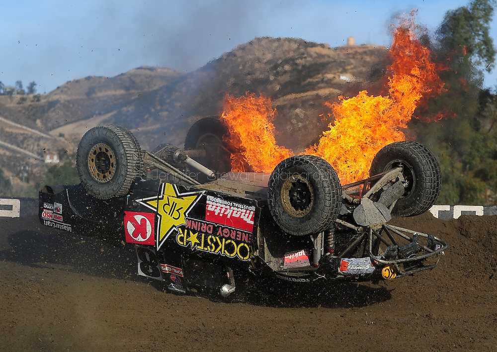 Dec. 19 2009; Lake Elsinore, CA, USA; LOORRS unlimited 2 driver Todd LeDuc is on fire after crashing on the last lap during the Lucas Oil Challenge Cup at the Lake Elsinore Motorsports Complex. Mandatory Credit: Jennifer Stewart-US PRESSWIRE