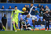 Birmingham City midfielder David Davis battles with Huddersfield Town midfielder Joe Lolley during the Sky Bet Championship match between Birmingham City and Huddersfield Town at St Andrews, Birmingham, England on 5 December 2015. Photo by Alan Franklin.