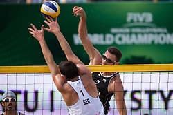 04.07.2013, Lake Szelag, Stare Jablonki, POL, FIVB Beach Volleyball Weltmeisterschaft, im Bild Block Jonathan Erdmann (#1 GER) - Angriff Ryan Doherty (USA), // during the FIVB Beach Volleyball World Championships at the Lake Szelag, Stare Jablonki, Poland on 2013/07/04. EXPA Pictures © 2013, PhotoCredit: EXPA/ Eibner/ Kurth ***** ATTENTION - OUT OF GER *****