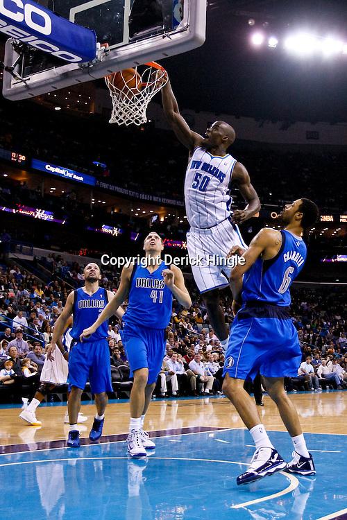 November 17, 2010; New Orleans, LA, USA; New Orleans Hornets center Emeka Okafor (50) dunks over Dallas Mavericks center Tyson Chandler (6) during the second half at the New Orleans Arena. The Hornets defeated the Mavericks 99-97. Mandatory Credit: Derick E. Hingle