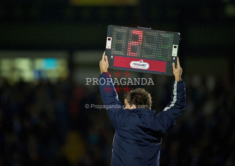 BRISTOL, ENGLAND - Tuesday, September 28, 2010: The fourth official indicates two minuets of injury time as Tranmere Rovers take on Bristol Rovers during the Football League One match at the Memorial Ground. (Photo by David Rawcliffe/Propaganda)