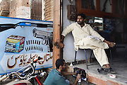 Celebrated young pakistani artist Asim Butt on a journey of political graffiti through Pakistan during the summer of 2009..Asim sprays a graffiti piece titled 'For the waste alone' in the gun market in central Multan.