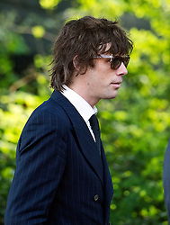 © London News Pictures. 21/04/2014 . Davington, UK. Razorlight frontman Johnny Borrell  arriving before the service.  The Funeral of Peaches Geldof. at St Mary Magdalene and St Lawrence Church in the village of Davington, Kent. Peaches Geldof, daughter of Irish singer-songwriter and political activist Bob Geldof, died on Apr. 7 at her home in southeastern England. Her death still remains unexplained.  Photo credit : Ben Cawthra/LNP
