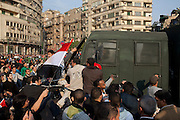 "Protestors attack an Egyptian riot police troop carrier during January 25, 2011 ""Day of Anger"" demonstrations in downtown Cairo, Egypt. Today's protests across Egypt, inspired by the revolution in Tunisia, were organized by a wide range of opposition groups and intended to spark a similar movement in Egypt. Credit: Scott Nelson"