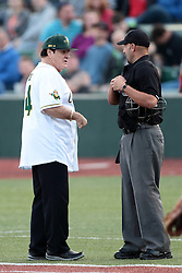 09 July 2015: Pete Rose know affectionately to fans as Charlie Hustle the current Major League Baseball all time hits leader acts as manager for the night stopping top chat with plate umpire Scott Behn on his way to the 3rd base coaches box. Pete Rose night during a Frontier League Baseball game between the Schaumburg Boomers and the Normal CornBelters at Corn Crib Stadium on the campus of Heartland Community College in Normal Illinois