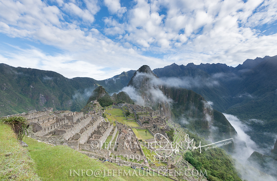 High in the Andes mountains the sunrise burns off the morning mist and reveals the Inca citadel of Machu Picchu.