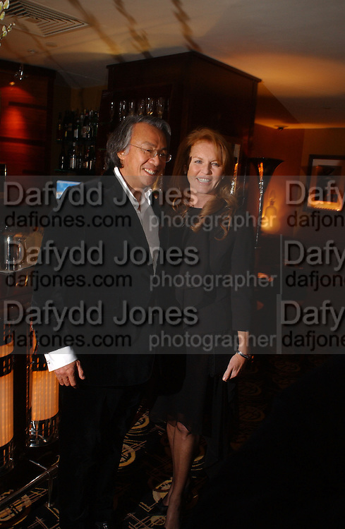 David Tang and The Duchess of York. The after show party following the UK Premiere of 'The White Countess', at China Tang, Park Lane London. March 19  2006. London. ONE TIME USE ONLY - DO NOT ARCHIVE  © Copyright Photograph by Dafydd Jones 66 Stockwell Park Rd. London SW9 0DA Tel 020 7733 0108 www.dafjones.com