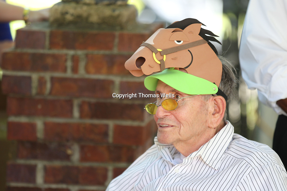 Alan Banks gets into the Derby Day theme by wearing a horse hat as he volunteers at Saturday's Derby Day fundraiser.