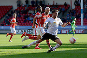 Crewe Alexandra midfielder Bradden Inman tripped by Walsall defender James O'Connor during the Sky Bet League 1 match between Walsall and Crewe Alexandra at the Banks's Stadium, Walsall, England on 26 September 2015. Photo by Alan Franklin.