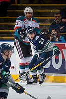 KELOWNA, CANADA - FEBRUARY 13: Luke Ormsby #23 of the Seattle Thunderbirds checks Devante Stephens #21 of the Kelowna Rockets into the boards on February 13, 2017 at Prospera Place in Kelowna, British Columbia, Canada.  (Photo by Marissa Baecker/Shoot the Breeze)  *** Local Caption ***