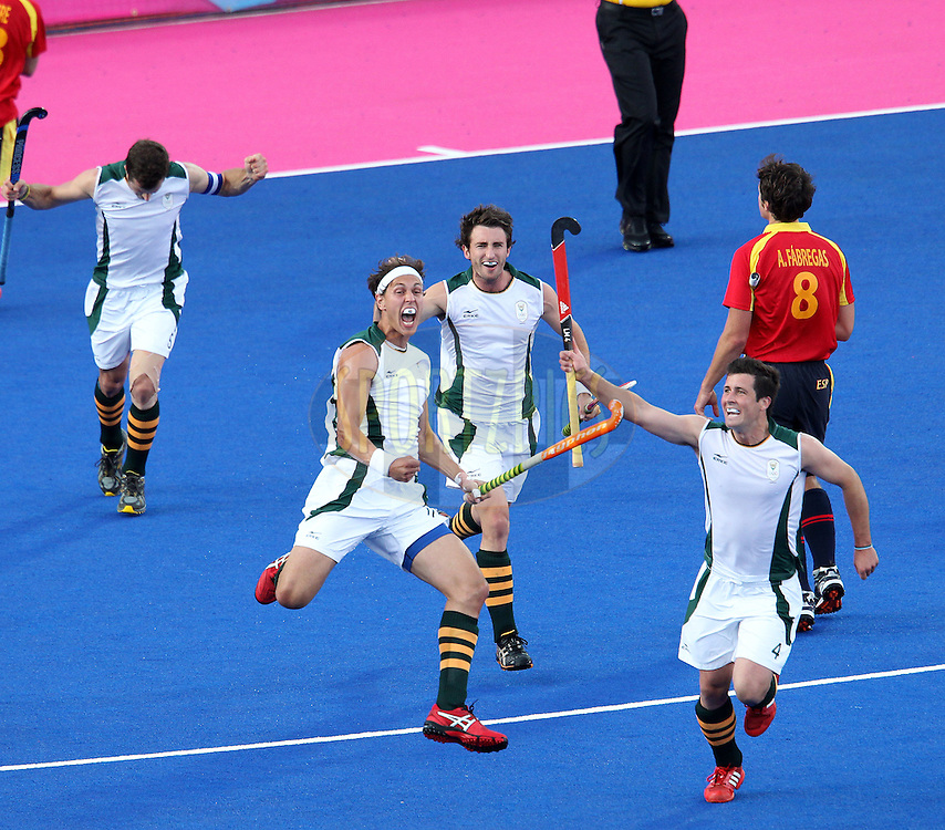 Justin Reid-Ross  of South Africa celebrates scoring for South Africa  during the Pool MA Hockey  match between South Africa and Spain held at the Riverbank Arena in Olympic Park in London as part of the London 2012 Olympics on the 3rd August 2012..Photo by Ron Gaunt/SPORTZPICS