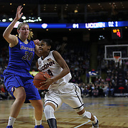 Moriah Jefferson, (right), UConn, drives to the basket past Megan Podkowa, DePaul, during the UConn Vs DePaul, NCAA Women's College basketball game at Webster Bank Arena, Bridgeport, Connecticut, USA. 19th December 2014
