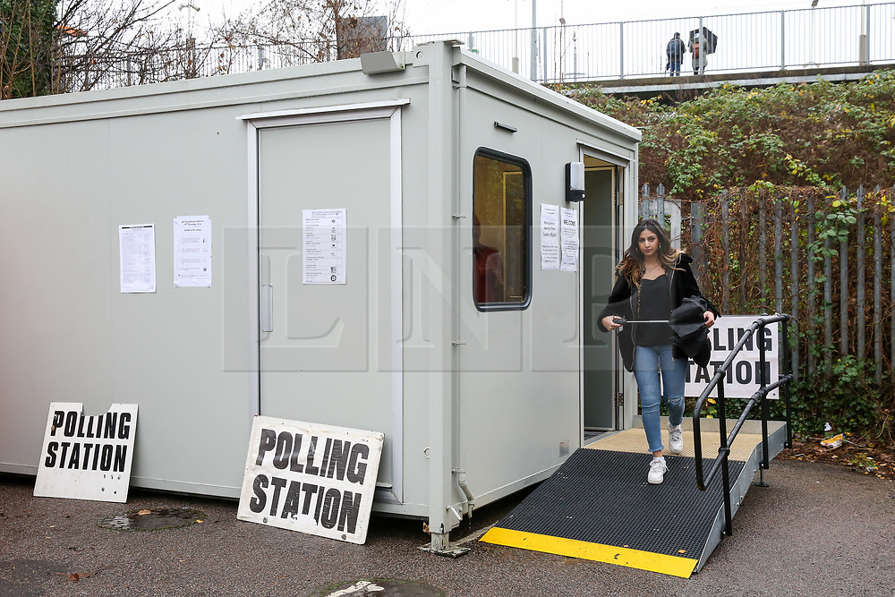 © Licensed to London News Pictures. 12/12/2019. London, UK. A woman leaves a portacabin used as a polling station in Haringey, north London after voting in the UK General Election. Photo credit: Dinendra Haria/LNP