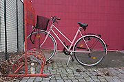 A locked bike in a rack next to dog faeces outside an apartment building in Wedding, a north-western district of Berlin.